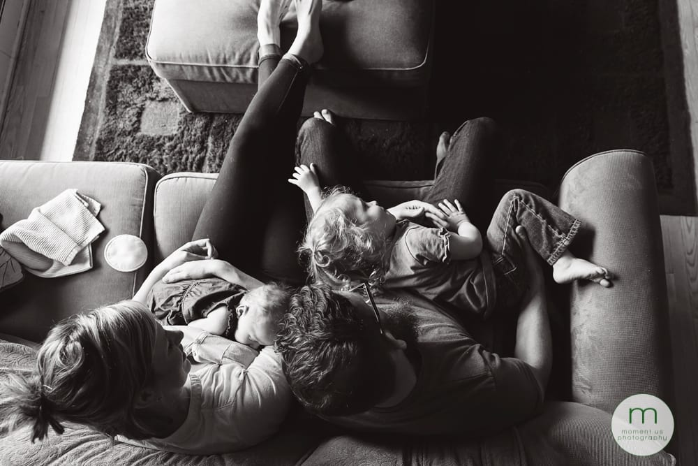girl lying in mother's lap