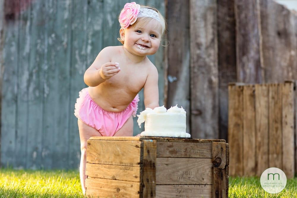 Cornwall child wearing pink diaper cover eating cake