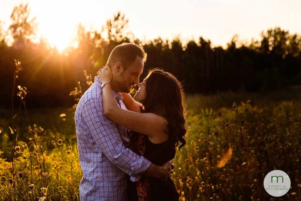 couple looking at each other in sunlight