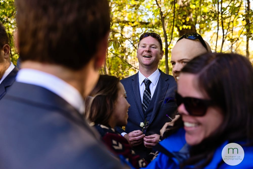 groom laughing with boutonniere