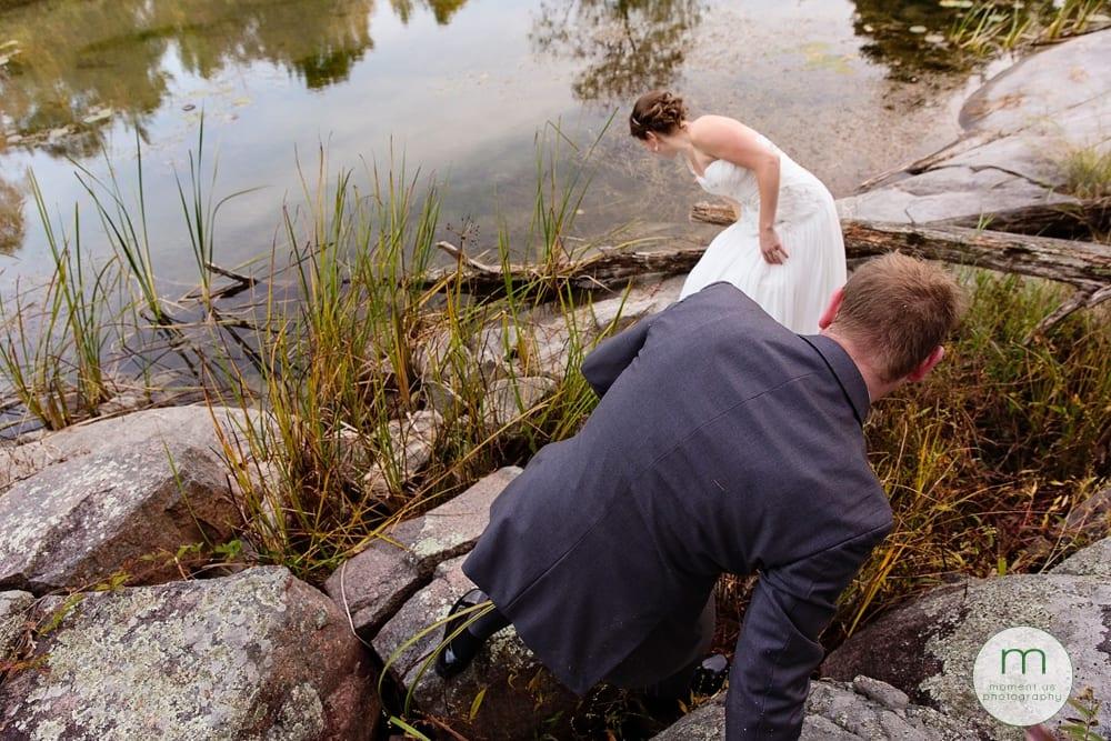 groom climbing down rocks