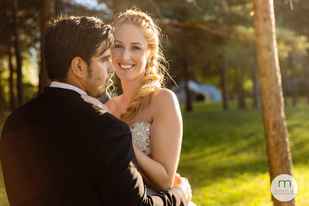 bridal portrait - bride looking at camera amongst trees