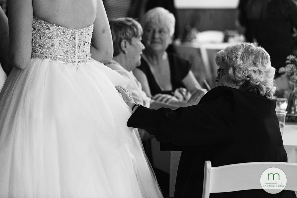 elderly woman fixing dress
