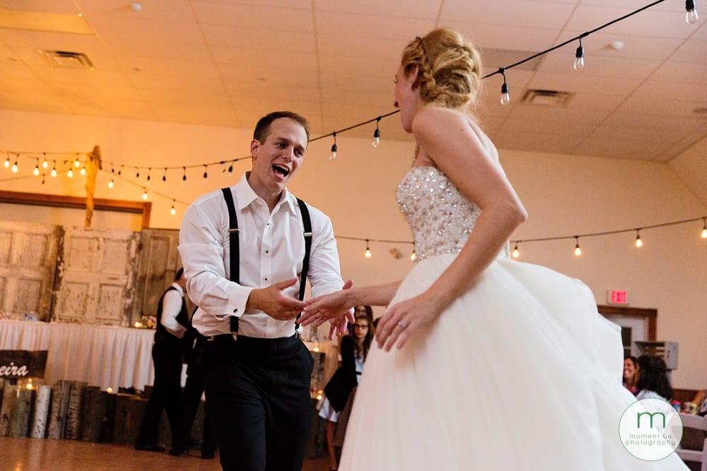 groomsman dancing with bride