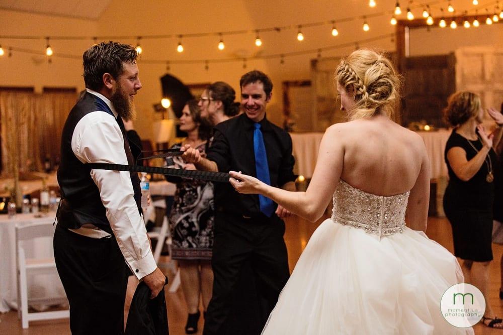 bride snapping suspenders