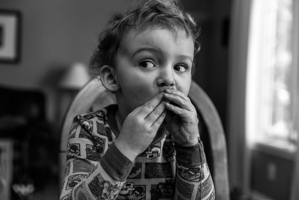 Cornwall family photography - boy eating frozen fruit