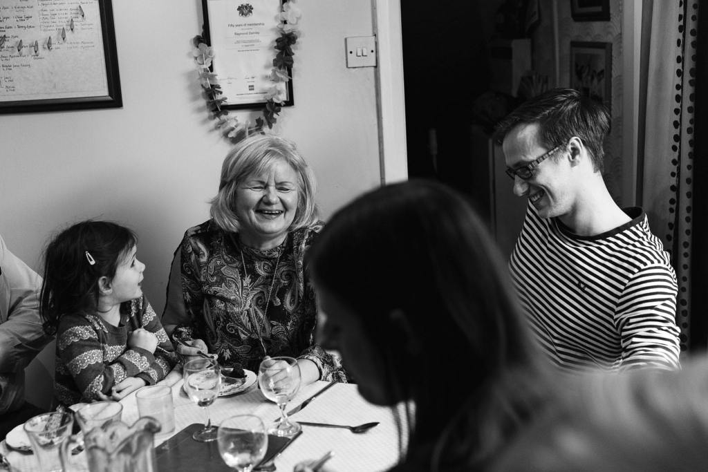 Daughter laughing during Manchester family lunch