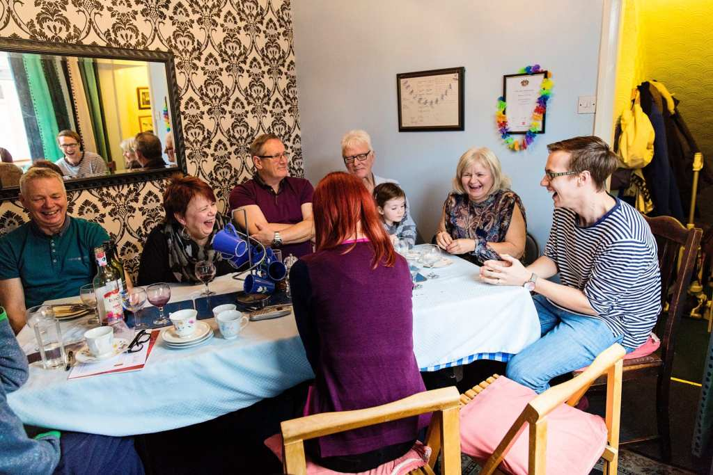 Grandson telling story during Manchester family lunch