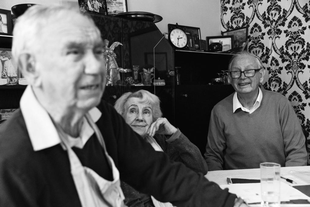 Grandmother looking at husband during Manchester family lunch