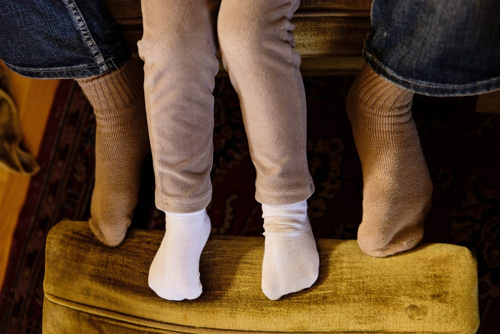 Cornwall family photographer - dad and daughter feet