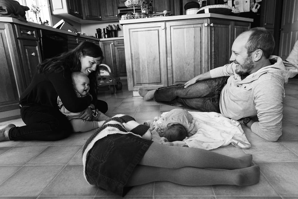 Cornwall family photographer - family on kitchen floor