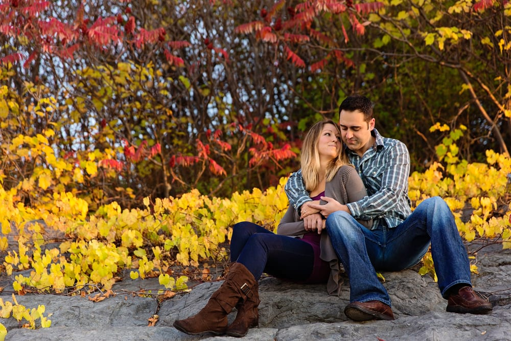 Ontario wedding photographer - couple cuddling for Cornwall engagement photos along the St Lawrence River
