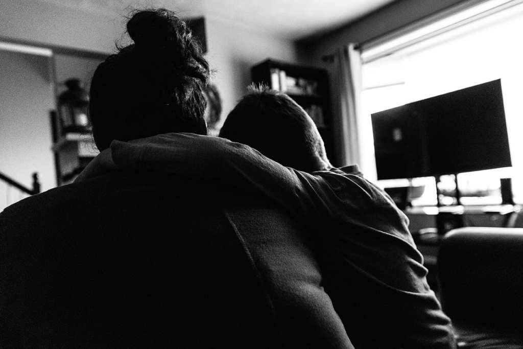 Son hugging mom - family photography in Cornwall