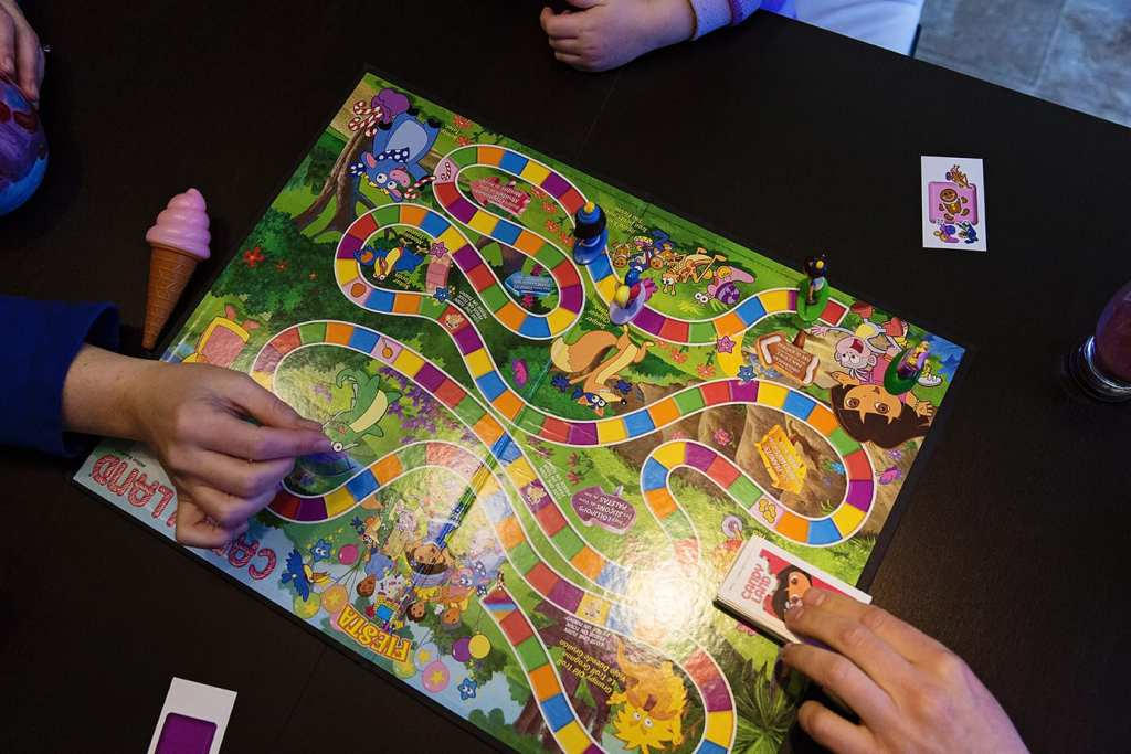 Family plays Candyland before breakfast