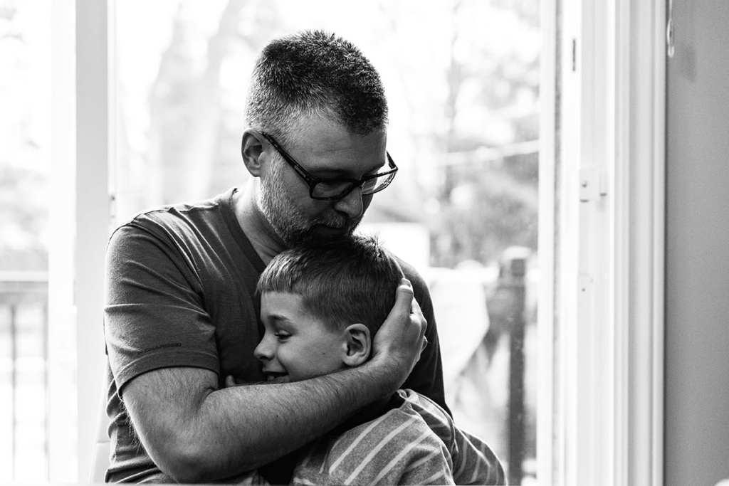 dad hugging son's head