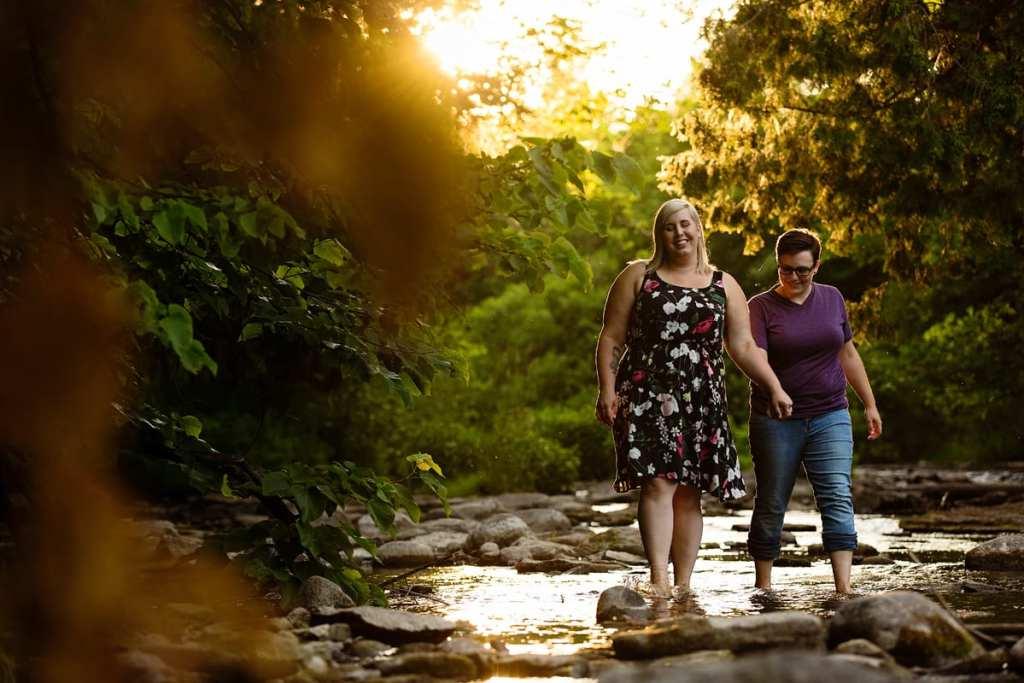 Women walking through rocky riverbed