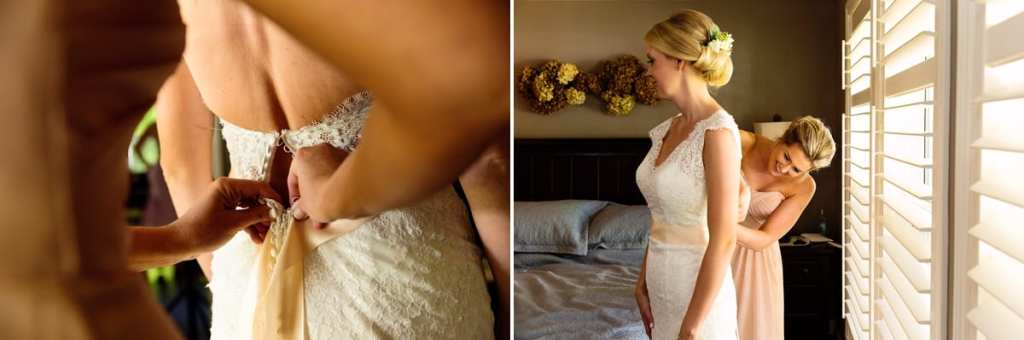 Bride in full lace wedding dress getting ready with bridesmaid