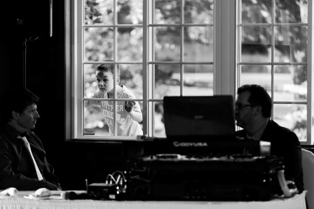 boy presses face against window behind Strathmere Inn DJ
