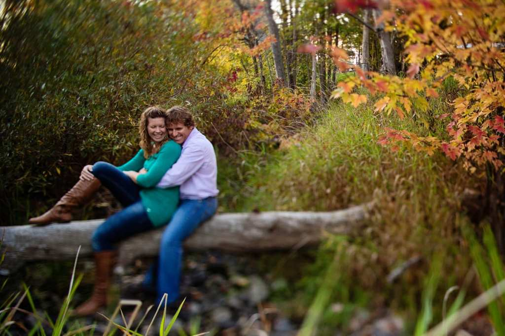 couple laughing during rural fall engagement session