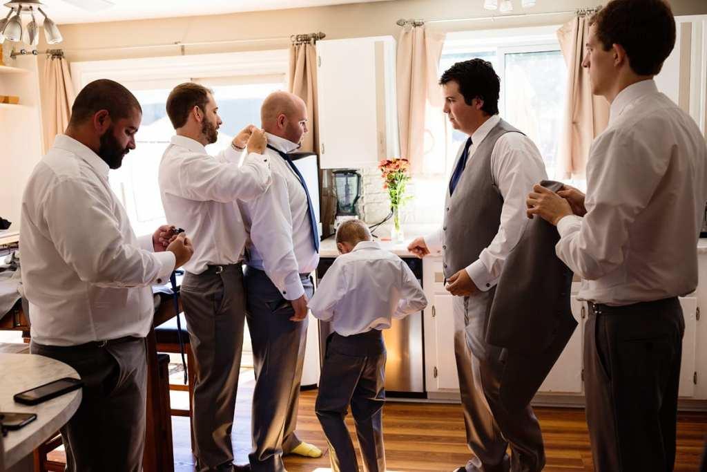 Cornwall groomsmen get ready in kitchen
