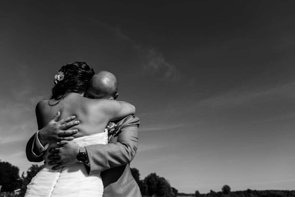 Bride and groom hug during first look