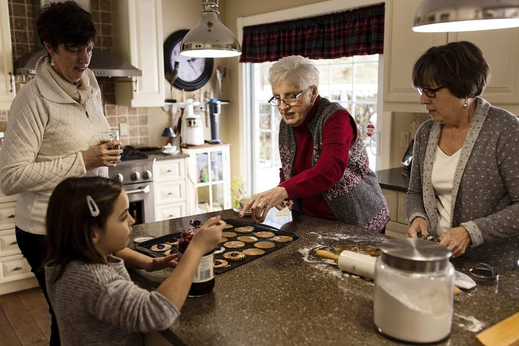 three generations bake cookies together in Cornwall family photos