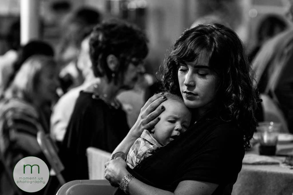 mother holds sleeping baby close to her while she closes her eyes