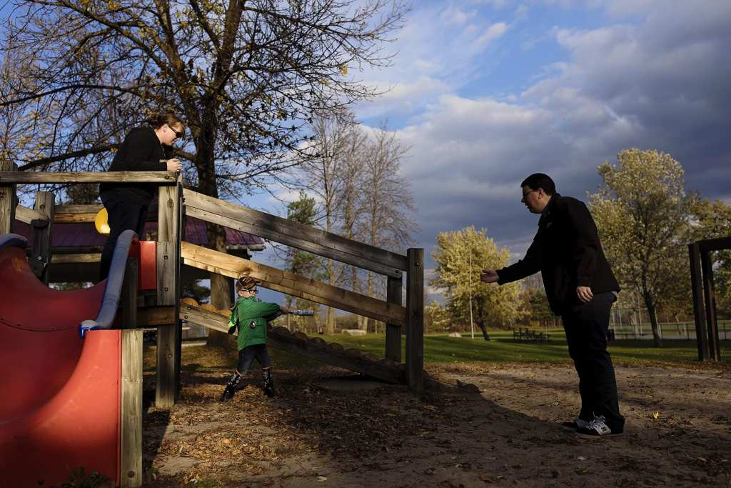 family plays ball at playground for Cornwall fall family photos