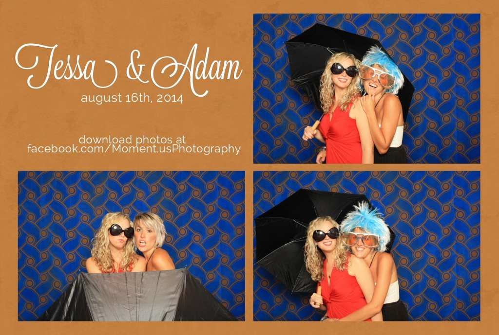 woman wearing blue wig and woman holding umbrella in wedding photo booth with blue and gold backdrop