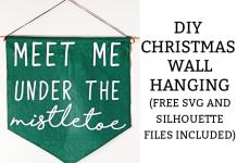 DIY Christmas wall hanging. Learn how to make this easy Christmas decoration using your Cricut or Silhouette. Free Christmas SVG file and Silhouette file included. #christmascraft #christmasdiy #cricut