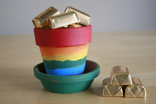Paint terra cotta planter rainbow colors and fill with chocolate gold.