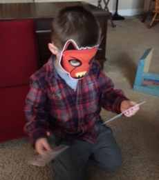 "My son wearing the ""big bad wolf"" mask"