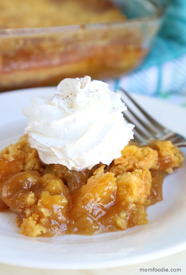apple dump cake with caramel and whipped cream