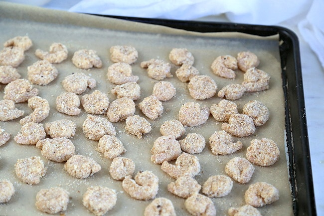 popcorn shrimp on baking sheet