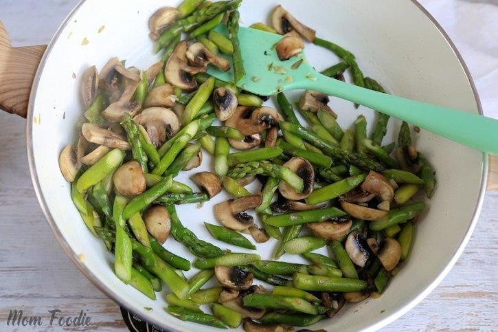 sauteed asparagus and mushrooms in pan