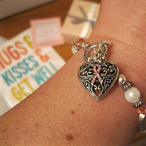 "This elegant and inspirational bracelet includes expressions of hope, courage and strength. With a pristine sterling finish, this bracelet is nestled in a pink gift box and includes a verse card stating ""Hope, Strength, Courage, Wear a pink ribbon, A symbol to share, Of hope, strength, and courage, To show you care."" A generous portion of the proceeds will go to the support of the breast cancer treatment, prevention and research."