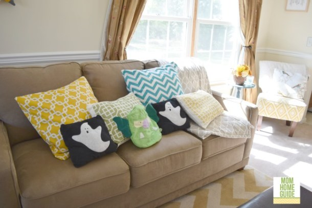 Love the Halloween throw pillows on this brightly decorated love seat!