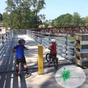 boys about to bike over a bridge