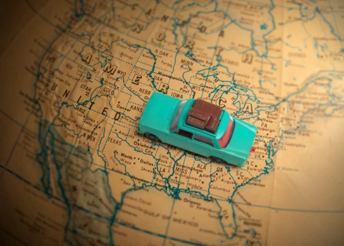 Toy Car on Road Trip With Kids going across a globe