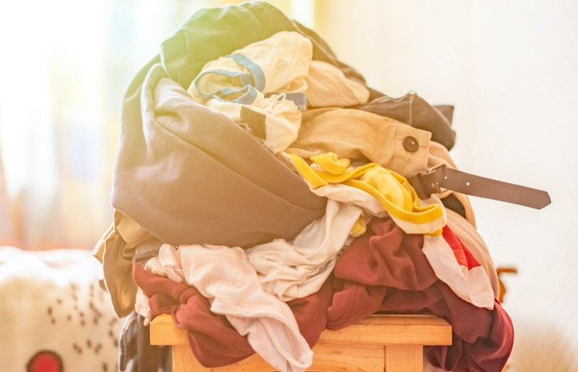 laundry piling up because the mom doesn't want to ask for help