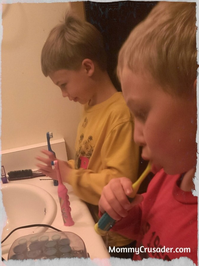 Second Grader and Kindergartner brushing their teeth. | MommyCrusader.com