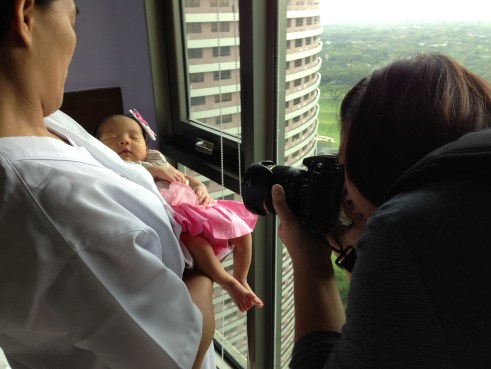 Polly Fong taking pictures of Zeeka, the Baby Fashionista