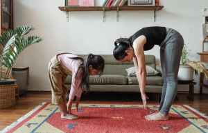 photo of woman and girl stretching their body