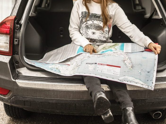 While packing for a road trip with kids, ensure everyone seated is comfortable, have their items stored away safely & are accessible if an emergency arises. #roadtrip #essentials #roadtripwithkids | mommygonetropical.com