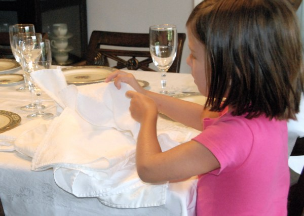 Folding the napkins-I had to really hold myself back from re-folding them!
