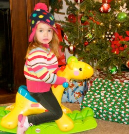Maddie trying out Addison's present from Santa at Sandra's on Christmas night.