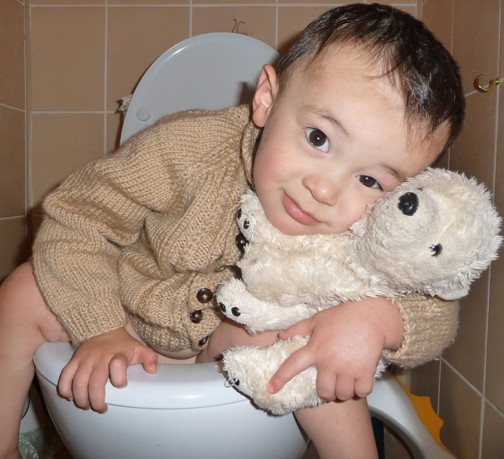 Kiyoshi hugging his bear on the toilet