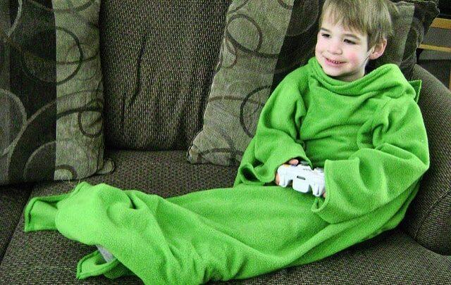 boy in green snuggie