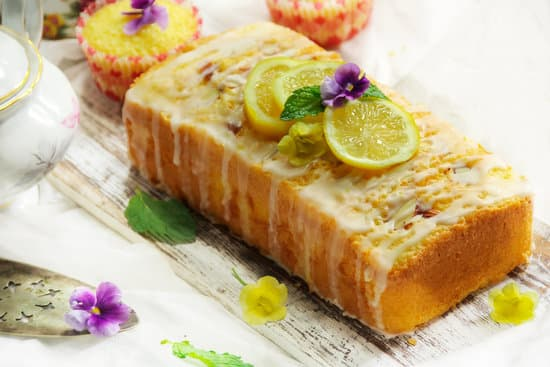 Homemade Moist coconut Pound Cake or Loaf on white background, selective focus