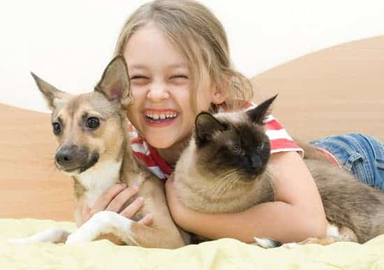 laughing girl with pets